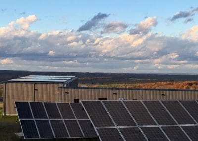Rooftop and ground mount solar array for Organic climbing company